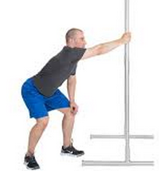 Standing, grab onto a pole or the fence. Sink back into your hips so that the arm is straight. You should feel a stretch underneath the arm. Hold for 30 seconds.