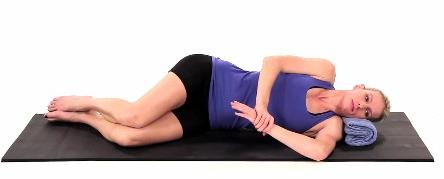 Lay on your side, pinning your shoulder blade down. Roll onto your shoulder and gently press down, bringing your palm towards the floor. You should feel a stretch behind the shoulder or into the arm. Hold 30 seconds.